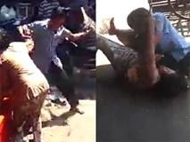 Người đàn ông vụt chổi, bóp cổ người già dã man ngay cổng chợ mà không ai can ngăn