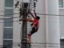 Khoảnh khắc kinh hoàng người đàn ông bị điện giật khi trèo lên cột điện nhìn Tổng thống Brazil