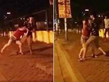 Cô gái mang bầu 4 tháng bị chồng hờ đánh đập giữa phố Hà Nội.