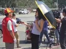 Nữ phóng viên bị đình chỉ vì đeo kính râm, cầm ô che nắng trong lúc tác nghiệp