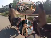 Rớt nước mắt với hoàn cảnh cô gái khoả thân chạy xe ngoài đường