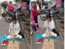 Cô gái xinh đẹp ngồi giữa đường xin tiền về Hà Nội
