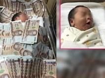 Đứa trẻ sơ sinh ngủ giữa đống tiền và nguyên do khiến nhiều người không khỏi ngao ngán