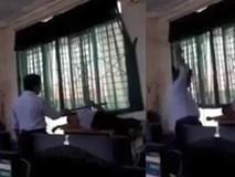 Học trò lười học, thầy giáo dùng gậy đánh