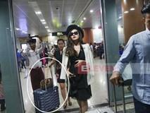 Á hậu Huyền My gây tranh cãi vì ảnh để mẹ đẩy hành lý ở Myanmar