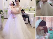 """Câu chuyện phía sau bức ảnh """"cô dâu cho con bú"""" trong ngày cưới"""
