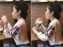 Cô gái gây sốc vì mặc đồ rách hở tơi tả ở quán cafe: