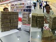 Cầm 'bao tải' tiền lẻ đi mua iphone 7, người đàn ông khiến cả cửa hàng bàng hoàng