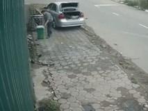 Người đàn ông đi ô tô và hành động khó hiểu với chiếc thùng rác