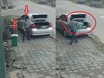 """Truy tìm người đàn ông đi ô tô """"cầm nhầm"""" thùng rác trên vỉa hè"""