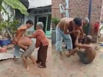 Cha mẹ già hơn 80 tuổi bị con trai đánh đập tàn nhẫn, mặc cháu gái đứng ngoài khóc lóc van xin