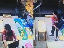 Clip: Người phụ nữ đột nhập vào cửa hàng nẫng laptop nhanh như chớp