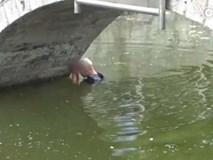 Tự tử bất thành vì nhảy xuống sông... quá nông