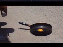 Clip: Nắng nóng kỷ lục 50 độ C, sinh viên Hà Nội mang trứng ra đường rán