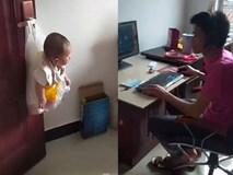 Bận chơi game, ông bố sáng tạo ra cách cho con vào túi nilon rồi treo lên cửa