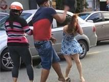 Truy tìm người đàn ông dùng mũ bảo hiểm đánh cô gái trên đường