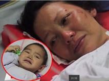 Tay vỡ nát, mẹ vẫn cố đào bới tìm con trai 4 tuổi bị gạch vùi lấp