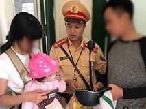 Cảnh sát giao thông thuyết phục thiếu phụ bế theo con nhỏ định nhảy cầu Chương Dương