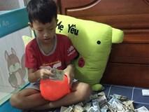 Câu chuyện đằng sau những tờ tiền lẻ của cậu bé lớp 4: Quyết khui heo