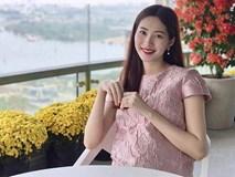 Hoa hậu Thu Thảo chính thức khoe ảnh lộ rõ bụng bầu vào mùng 2 Tết