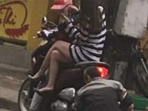 Ngồi im trên xe khi bác thợ bơm lốp, cô gái mặc váy ngắn bị chê bai, chỉ trích