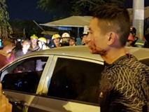 Đôi vợ chồng đi xe máy bị tài xế ô tô đánh be bét máu giữa đường xin… giảng hòa