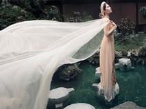 Không phải cứ mặc đồ gợi cảm mới đẹp, Ngọc Trinh diện áo dài vẫn thần thái đỉnh cao