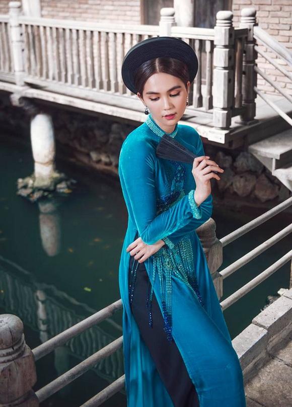 Không phải cứ mặc đồ gợi cảm mới đẹp, Ngọc Trinh diện áo dài vẫn thần thái đỉnh cao-9