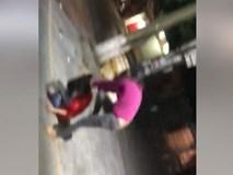 Vợ mới sinh con 5 tháng đánh ghen bồ giữa đường, chồng hèn lên ô tô bỏ trốn