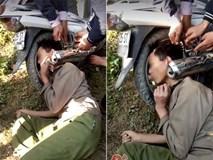 Hy hữu: Người dân giải cứu ông chú bỗng dưng mắc kẹt đầu vào bánh xe máy và ống pô