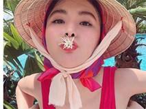 HÀI HƯỚC: Tung tăng bơi lội, Angela Phương Trinh vẫn không quên chống nắng bằng... nón lá