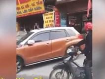 Bị CSGT nhắc nhở, nữ tài xế đỗ ô tô giữa đường chống đối
