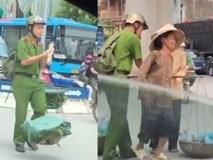 Nam sinh cảnh sát giữa trưa nắng giúp 2 bà cụ gánh rau qua đường