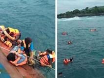 Video: Hành khách trên chiếc phà lật ở Indonesia bám víu vào một bên phà để khỏi rơi xuống biển