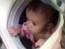 Trung Quốc: Ung dung ngồi trong máy giặt, bé gái 1 tuổi được lính cứu hộ đưa ra khỏi vùng mưa lũ an toàn