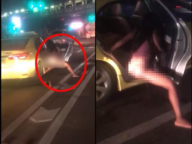 Đang dừng đèn đỏ, cô gái thò chân xuống ôtô làm một hành động khiến người đi đường choáng váng-1
