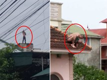 Vụ gã đàn ông thả bé trai hơn 1 tuổi từ mái nhà xuống: Cháu bé được đỡ kịp thời, nghi là con của đối tượng