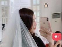Bạn gái Tiến Dũng đăng ảnh đội khăn voan trắng như cô dâu, dân tình đồng loạt gọi tên Đình Trọng