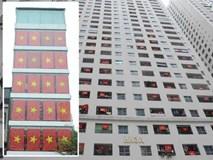 Người dân chung cư ở Hà Nội đồng loạt treo cờ cổ vũ đội tuyển Việt Nam trước trận chung kết lượt đi gặp Malaysia