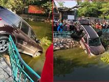 Lái xe cắm đầu xuống hồ Trúc Bạch - Hà Nội, tài xế còn đòi nổ máy lùi xe lên