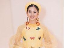Hoa hậu Tiểu Vy đẹp mơ màng với áo dài, làm vedette sàn catwalk