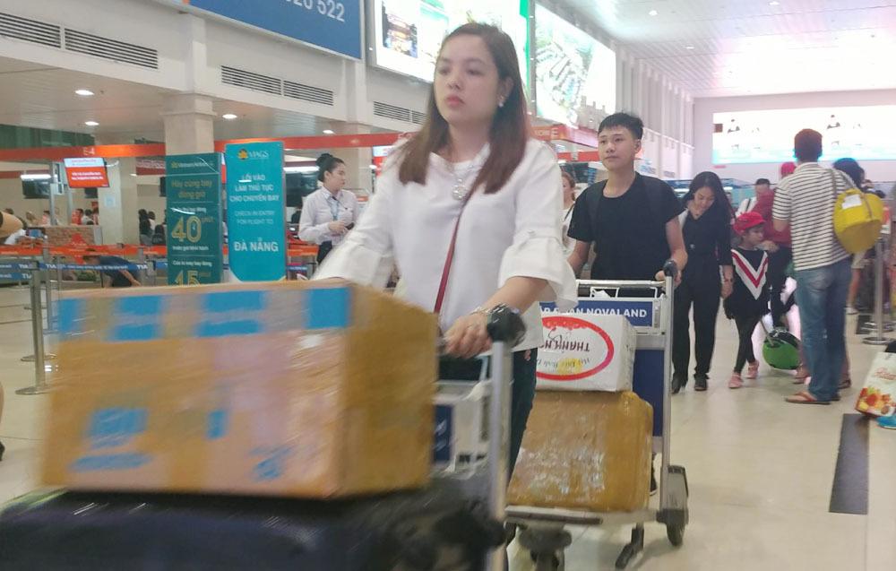 Tân Sơn Nhất khuyến cáo khách không bịt mặt đến sân bay dịp Tết-1