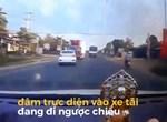 Phản xạ nhanh khó tin: Người phụ nữ đòi con khỏi bánh xe container trong tích tắc!-1