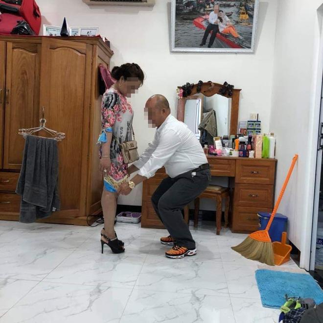 Bức ảnh người đàn ông kéo váy vợ khiến dân mạng xôn xao: Quan tâm hay chỉ là ích kỷ?-1