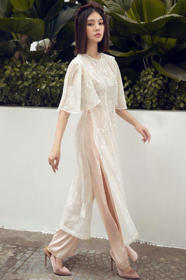 Sau ồn ào với hội bạn thân, Jolie Nguyễn tung bộ ảnh diện áo dài đón Tết cực dịu dàng-9