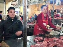 Chia tay Asian Cup, trung vệ Bùi Tiến Dũng về nhà bán thịt lợn cho mẹ