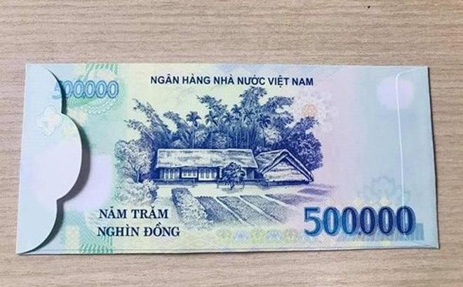 Sử dụng bao lì xì có hình tiền Việt Nam sẽ bị phạt đến 80 triệu đồng-1