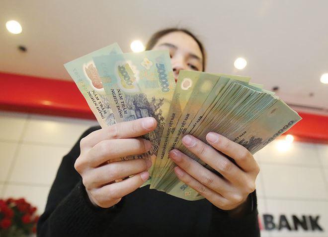 Tiết lộ mức thưởng Tết của nhân viên ngân hàng-1