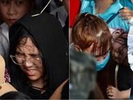Ảnh: Mệt mỏi vì chen lấn giữa hàng vạn người dù chưa khai hội chùa Hương, nhiều em nhỏ ngủ gục trên vai mẹ