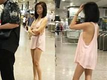 Mặc lớp áo mỏng hờ hững không nội y đi rút tiền, cô gái gây bão mạng xã hội